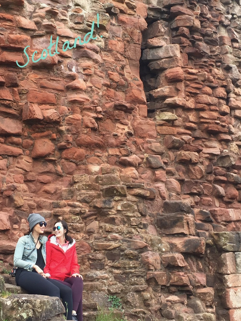 In Scotland sitting on Bothwell Castle - Em and Kate- Two Being Healthy